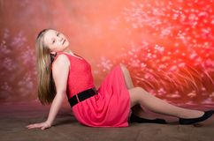 Young girl in red dress pose in studio Stock Photo