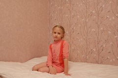 Young girl in red dress. In thd room Stock Photos