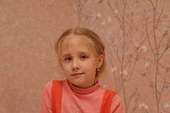 Young girl in red dress. In thd room Stock Photography