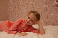 Young girl in red dress. In thd room Royalty Free Stock Photo