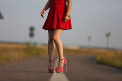 Young girl in red dress Stock Photos