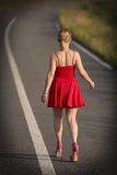 Young girl in red dress Royalty Free Stock Photography