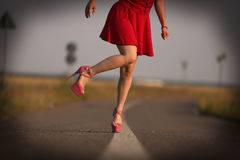 Young girl in red dress Stock Images