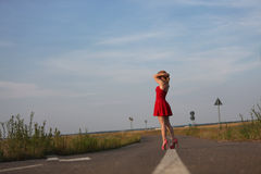 Young girl in red dress Royalty Free Stock Images