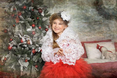 Young girl in a red dress with a white bolero Royalty Free Stock Photo