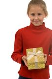 Young girl in red with gold Christmas present Royalty Free Stock Photos