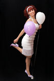 Young girl with red hair and balloons. Girl with the ribbon in the hair and balloons Stock Photo
