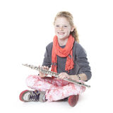 Young girl with red hair and freckles with flute Stock Photos