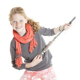 Young girl with red hair and freckles holding flute Stock Images