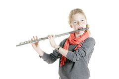 Young girl with red hair and freckles plays flute Royalty Free Stock Photo