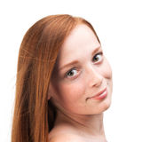Young girl with red hair isolated on white background Royalty Free Stock Photography