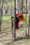 A young girl with red hair walks in the Park in a good mood. Happy girl. stock photography