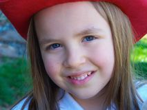 Young girl with red hat Royalty Free Stock Image