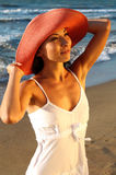 Young girl in red hat on the beach Stock Photos