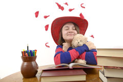 Young girl with red hat loving her teddy bear isolated Stock Photos