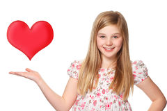 Young girl with a red heart Stock Photos