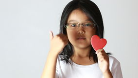 Young girl with red heart Royalty Free Stock Photos