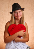 Young Girl With Red Heart Stock Photo