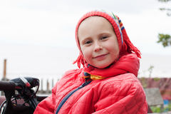 The young girl in a red jacket. On the nature stock photos