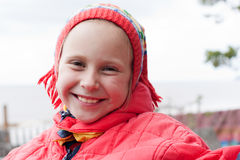 The young girl in a red jacket. On the nature stock images