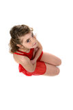 Young girl in red leotard kneeling Royalty Free Stock Images