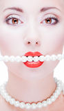 Young girl with red lips. And prearl string Royalty Free Stock Photography