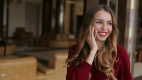 Young girl with red lipstick talking on the phone and laughs. stock footage