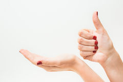 Young girl with red manicure holding hand Royalty Free Stock Photos