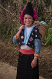 Young girl red pompons Hmong. This costume are for girls no married . Ethnic red Hmong in Pha Din Pass Royalty Free Stock Photo