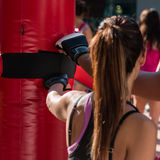Young Girl and Red Punching Bags and Mitts, Boxing & Fitness Stock Photos