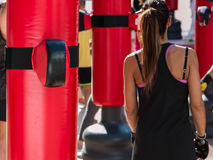 Young Girl and Red Punching Bags and Mitts, Boxing & Fitness Royalty Free Stock Image
