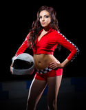 Young girl in red racing costume Stock Photos