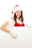 Young girl in red Santa hat  with billboard Stock Images