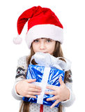 Young girl in red santa hat holding gift box. isolated on white Royalty Free Stock Photography