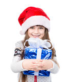 Young girl in red santa hat holding gift box.  on white Royalty Free Stock Photography