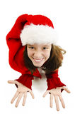 Young girl in red Santa hat. Looking up expects gifts from Santa for Christmas Stock Photos