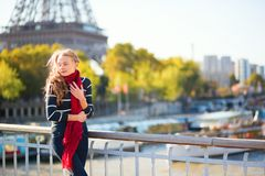 Young girl in red scarf on a fall day in Paris Stock Photo