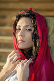 Young girl with red scarf Royalty Free Stock Photos