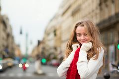 Young girl in red scarf on a Parisian street Royalty Free Stock Photo