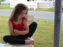 Young Girl. In red shirt and black pants outside Stock Photos