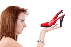 Young girl with a red shoe Stock Photography