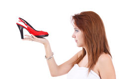 Young girl with a red shoe Royalty Free Stock Photos