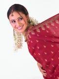 Young girl in red silk sari Stock Photos
