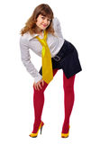 Young girl in red stockings and a yellow shoes. Isolated on white background Royalty Free Stock Photography