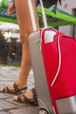 Young girl with red suitcase close-up. Travel. Stock Photo