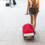 Young girl with red suitcase. Travel. Royalty Free Stock Images