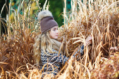 Young girl in a reed Royalty Free Stock Photo