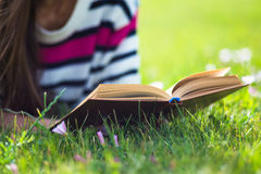 Young girl relax with book in summer park. Royalty Free Stock Images