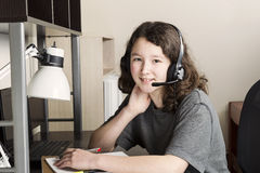 Young Girl Relaxed while doing her homework Stock Photo