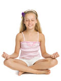 Young girl relaxes in a yoga pose Royalty Free Stock Photography